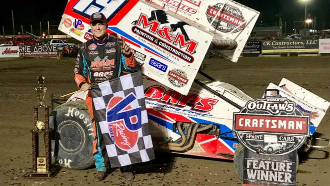 Brent Marks poses for photos after winning June 2 at Wilmot Raceway for his first World of Outlaws feature victory.