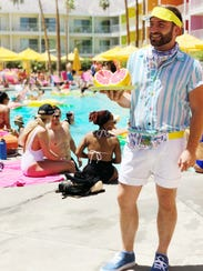 A poolside employee at Saguaro Palm Springs shows off