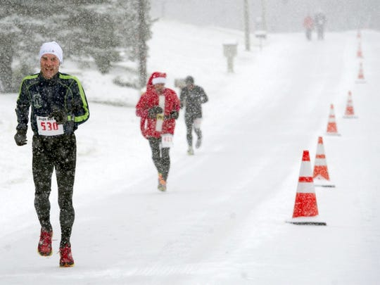 Brian Friedland of the York Road Runners is in the Santa suit enjoying the Jungle Bell 5-K on December 7, 2013.