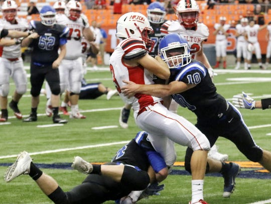 Matt Robert of Horseheads makes a tackle against Hilton at the Carrier Dome in Syracuse in 2017.
