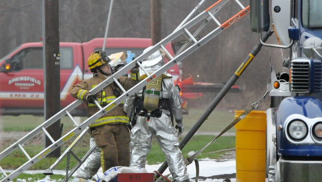 A hazmat team tries to contain a fuel spill that can be seen leaking out of the side of the tanker truck. The spill took place between Marion and Home Roads around 6AM on Wednesday. Jason J. Molyet/News Journal