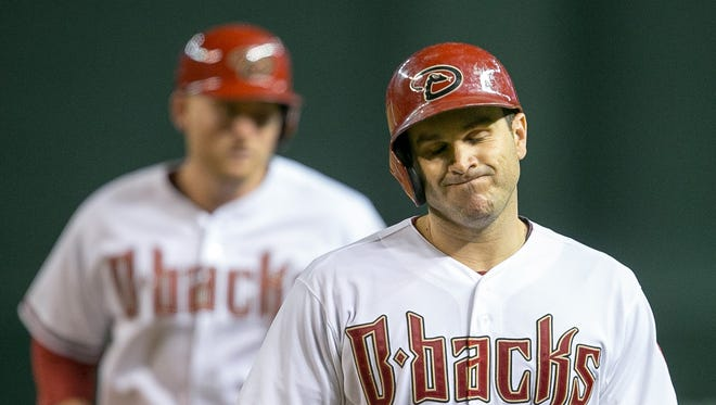 Arizona Diamondbacks catcher Miguel Montero reacts to his pop out during their baseball game against the Colorado Rockies at Chase Field in Phoenix on Friday, August 29, 2014.