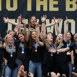 Members of the U.S. women's soccer team celebrate the team's World Cup championship during a public celebration, Tuesday, July 7, 2015, in Los Angeles. This was the first U.S. stop for the team since beating Japan in the Women's World Cup final Sunday in Canada.