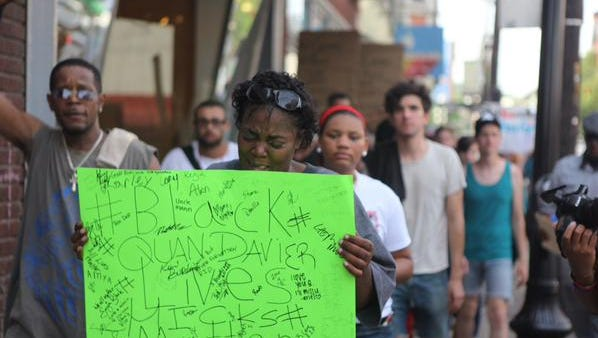 Erica Woods, QuanDavier Hicks' mother, marches.