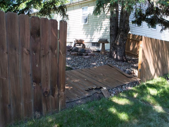 A fence on Gary Avenue was struck by the car on Thursday,