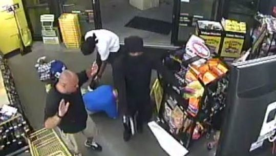 Deputies said the pair entered the store, 701 Gretchen Ave. S., one with a black handgun and one with a silver one, and demanded money.