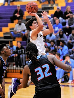 Wylie's Steven Lopez rises up in the lane for a floater during Tuesday's 55-49 loss to Wichita Falls Hirschi.