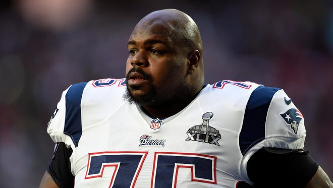 New England Patriots defensive tackle Vince Wilfork warms up before Super Bowl XLIX against the Seattle Seahawks at University of Phoenix Stadium.