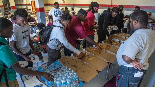 Maplewood football players are served meals  by the Fellowship of Christian Athletes at Maplewood High School on  Oct. 16.