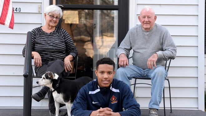 Seton Catholic High School basketball star and Mr. Basketball candidate Desmond Bane with his great grandparents Fabbie Bane and Bob Bane, right, and dog Spark Wednesday, March 16, 2016 in Richmond.