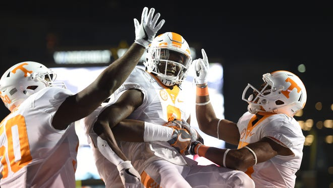 Tennessee running back Alvin Kamara (6) is congratulated after scoring the first touchdown of the game during the first half at Vanderbilt Stadium on Saturday, Nov. 26, 2016.