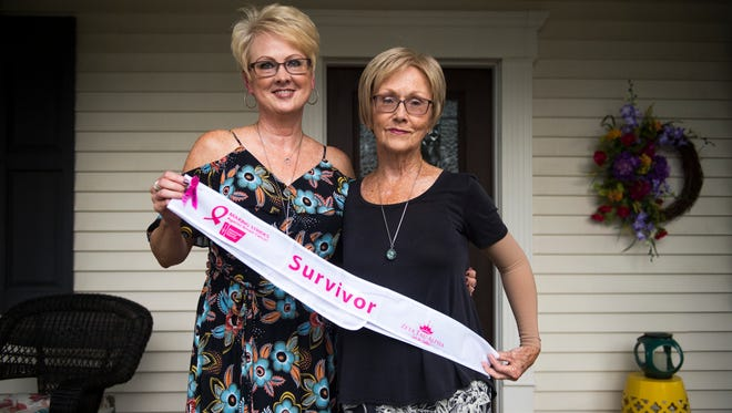 Debbie Pearsall, left, and her mother, Martha Wilson, stand outside their McMinnville home Sept. 19, 2017. Both are breast cancer survivors and advocates for the importance of early detection and treatment.