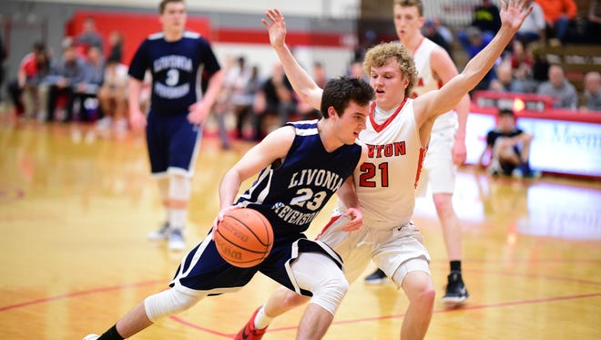 Back to help their respective teams are Livonia Stevenson's Devin Dunn (left) and Canton's Connor Engel.