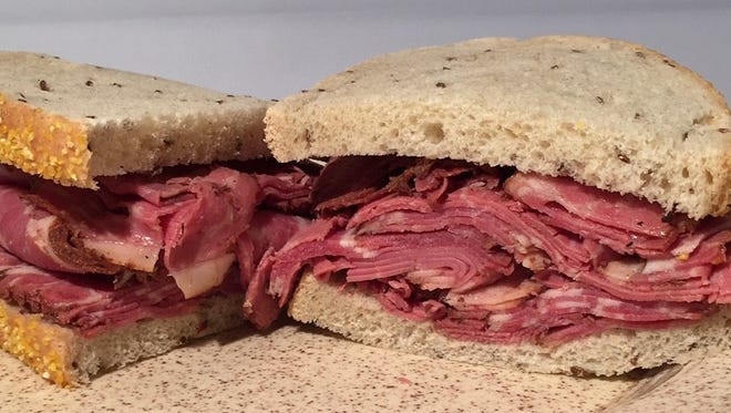 Pastrami or corned beef picnic pacs with rye bread and pickles and coleslaw