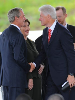 ORG XMIT: JG 40672  9/11/2011  9/10/11 2:15:05 PM -- Shanksville, PA, U.S.A  -- 9/11 Shanksville coverage --  Former Presidents George W. Bush and Bill Clinton at the September 10 dedication ceremony of the Flight 93 National Memorial in Shanksville, Pennsylvania.  Photo by Jack Gruber, USA TODAY Staff  (Via OlyDrop)
