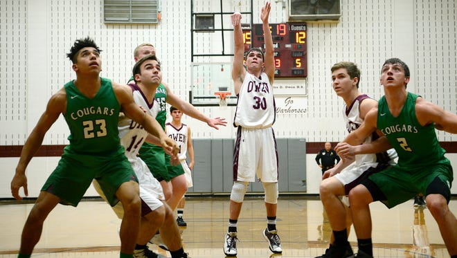 Owen and Mountain Heritage met in this week's semifinals of the Western Highlands Conference basketball tournament in Swannanoa.