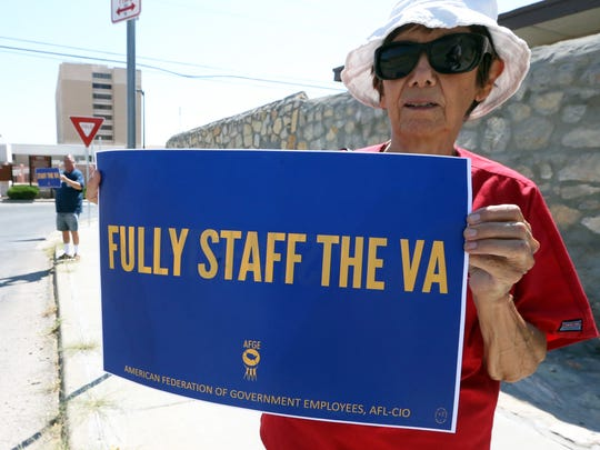 Sylvia Searfoss of the National Nurses United Union stands outside the Department of Veterans Affairs clinic during a rally Wednesday highlighting VA job vacancies nationwide.