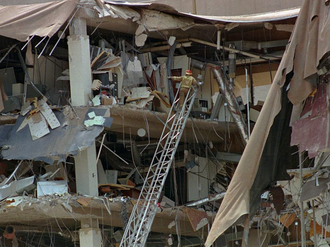 Firefighters search the rubble of the Alfred Murrah