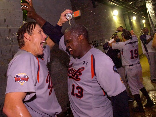 The York Revolution's Val Majewski, left, and Vince Harrison celebrate outside of their locker room following their 5-4 victory over the Lancaster Barnstormers on Monday to win the series and advance to the championship series.