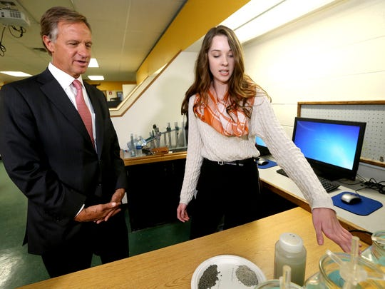 Tennessee Governor Bill Haslam left listens to Central Magnet High School senior Ashley Pelham explains a water purification project using okra, that she and fellow senior student Sophia Hall, not photographed, are working on as their senior theis, on Wednesday, Jan. 25, 2017.
