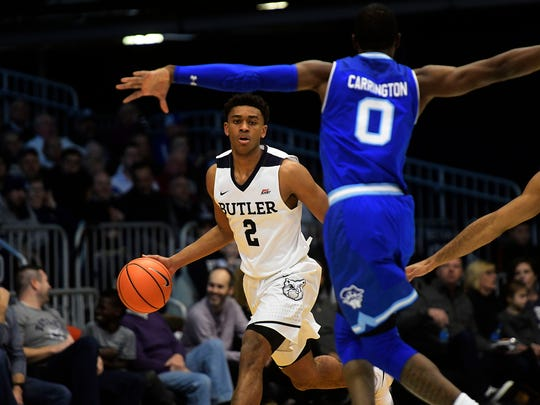 Butler Bulldogs guard Aaron Thompson (2) dribbles the ball in the first half against the Seton Hall Pirates at Hinkle Fieldhouse.