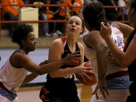 Burkburnett's Lorrin Peigue looks to the basket as Hirschi defenders close in Tuesday, Feb. 6, 2018, at Hirschi.