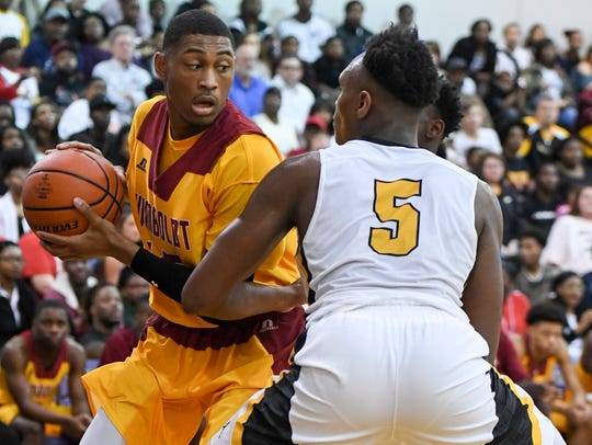 Peabody's Khance Hill guards Humboldt's Anthony Jones