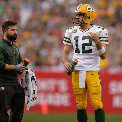 Green Bay Packers quarterback Aaron Rodgers talks to