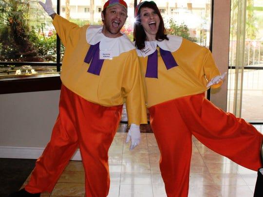 Tweedle Dum Jeremy Elkins and Tweedle Dee Aimee Adams enthusiastically greet guests.