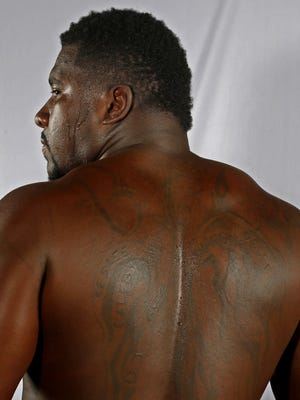 Cincinnati Bengals Wallace Gilberry shows off the tattoo of his family tree on his back.