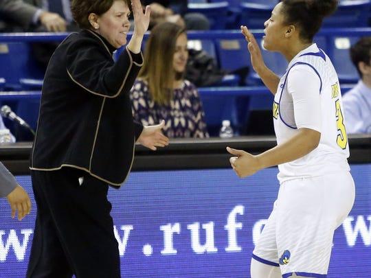 Delaware guard Erika Brown high-fives coach Tina Martin during a 2016 game.