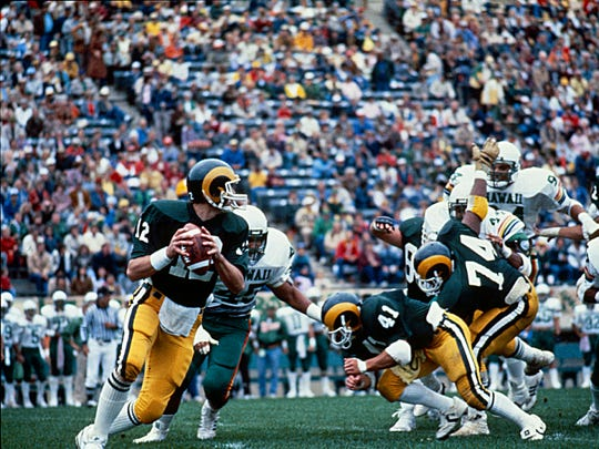 CSU quarterback Kelly Stouffer drops back to pass during a 1986 game against Hawaii at Hughes Stadium. Stouffer, now a television analyst with ESPN, was selected No. 6 overall in the 1987 NFL draft and played four seasons in the league.