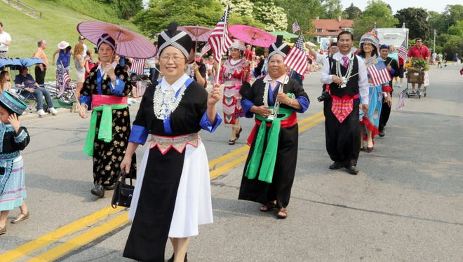 Sheboygan Hmong community memebers march in the Independence Day Parade on July 4 in Sheboygan.