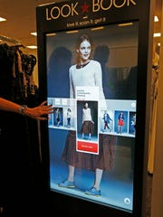 "The ""Look Book"" assists shoppers looking for that certain fashion look, have been placed throughout Macy's Kenwood Towne Centre store. See an item you like, but want to browse for a different color? The screen allows customers to do that on a large display. It's just one the latest ways Macy's is using technology to enhance shopping and drive sales."