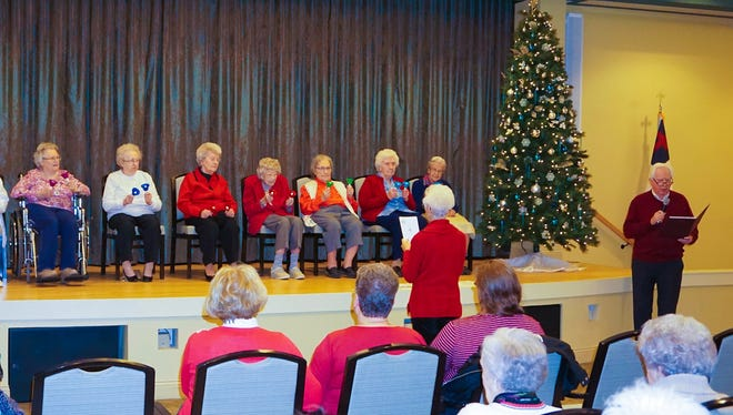 The StoneRidge Bell Ringers, a musical group made up of nine StoneRidge residents, performed in a concert Dec. 1 at StoneRidge Poplar Run's Theatre on Main. The group, under the direction of Ruth Ann Weidman, performed classic songs as well as sacred and seasonal favorites, according to news release issued by StoneRidge. On stage, left to right, Betty Jane Wentling, Eleanor Milovich, Emily Shaw, Hilda Gettle, Marnetta Snyder, Gladys Weise, Meda White, Arlene Crouse and Mary Weik.  Ruth Ann Weidman, director is in red with her back to the camera. Also pictured, standing at the far right, is soloist Bob Levin.