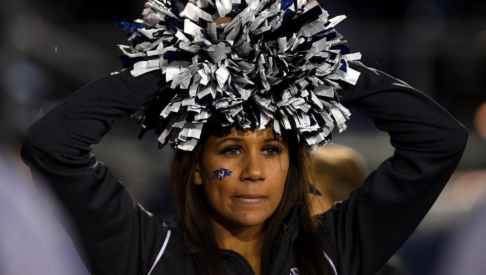 A Nevada cheerleader shows a worried look late in the