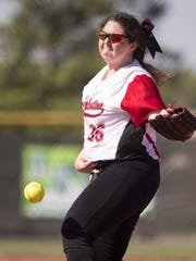 Elisha Barker pitches for New Palestine High School on Saturday as the Dragons beat Kankakee Valley High School 13-6 for the 3A state softball title. Barker is one of five seniors to play their last innings in a Dragons uniform Saturday.