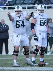 Michigan State linemen Matt Allen (64) and Blake Bueter (66) during the 2018 spring game at Spartan Stadium.