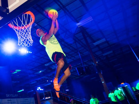 Ricky Williams, 16, of Brick shows off his skills at basketball during GLOW at  Sky Zone in Lakewood.