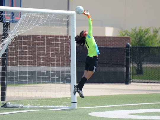 Wylie keeper Arianna Taylor (1) gets her finger tips on the ball for a save late in the second half of the Region I-4A semifinal against Fort Worth Castleberry at the Birdville ISD Fine Arts/Athletics Complex on Friday, April 13, 2018. The Lady Bulldogs won 5-2.