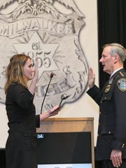 Chief of Police Edward Flynn takes the oath of office during a ceremony at the Milwaukee Safety Academy in 2-16 for his third four-year term as Milwaukee's Chief of Police.  The oath of office was given to him by Milwaukee Fire and Police Commission, Executive Director MaryNell Regan (left).