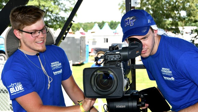 MTSU senior Andrew Stephens (left) and junior Austin Forsberg, both video film production majors in the College of Media and Entertainment, prepare a camera for use on the Who Stage at the 2018 Bonnaroo Music and Arts Festival.