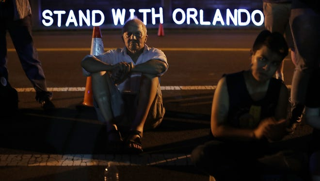 Gun control activists participate in a vigil in front of the National Rifle Association (NRA) on Monday, June 20, in Fairfax, Virginia.