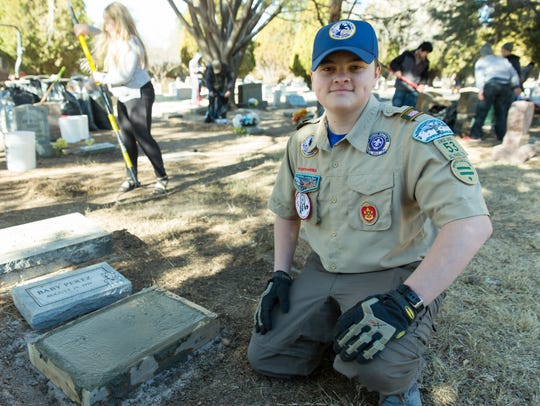 Gunnar Smith, 15, is pictured at Masonic Cemetery on Saturday, January 27, 2018. Gunner decided to help place headstones for forgotten children at the cemetery as his Eagle Scout Service Project. About 20 friends and family helped with the project.