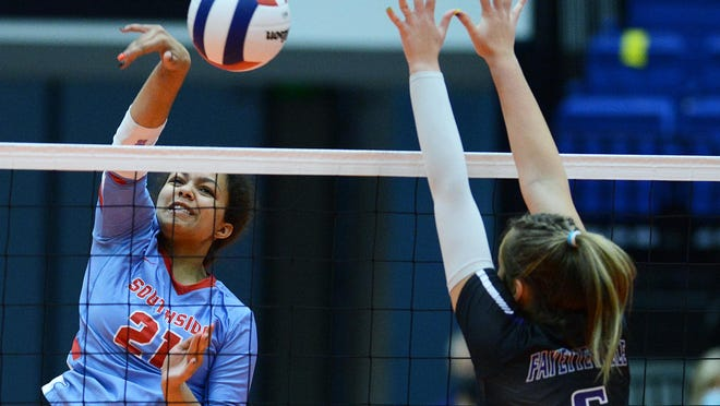 Southside's Aleigha Johnson hits a kill shot past Fayetteville's Regan Harp in the first set during the 6A state championship in the Hot Springs Convention Center on Saturday, Oct. 31.