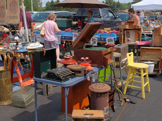 People shop at the Mega Mall Flea Market in Lansing