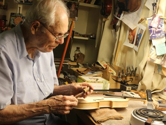 Hilton Lytle in his fiddle workshop at his home in