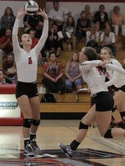 Mollie Bartlett (6) sets a ball during Lourdes Academy's match against Central Wisconsin Christian on Tuesday.