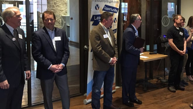 City Council candidates, from left, John Paulson, Marshall Selberg, Ritch Noble, Manny Steel and Jacob Johnson wait to address a room full of young professionals Tuesday evening at Prairie Berry East Bank in downtown Sioux Falls.