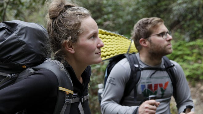 In this March 30, 2020, photo, Alexandra Eagle, left, and Jonathan Hall soak up their last moments hiking the Appalachian Trail in Cosby, Tenn. The couple is postponing the 2,190-mile hike until the coronavirus pandemic ends. (AP Photo/Sarah Blake Morgan)
